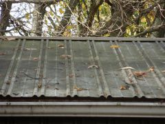 metal roof before Kleen Llc cleaned It